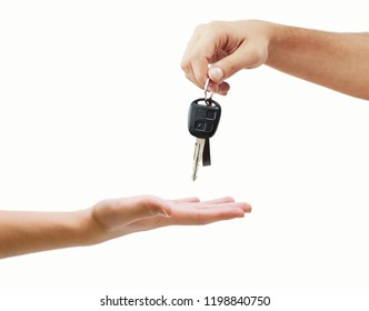 Hand giving car key closeup isolated on background