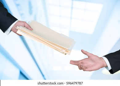 Hand giving documents.