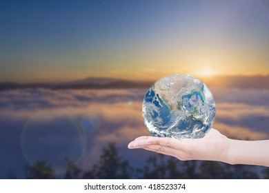 Hand giving the Earth. save the earth. Elements of this image furnished by NASA. Global warming effect. World Environment Day CSR