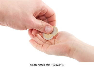Hand giving euro coins in a hand of a child isolated on a white background