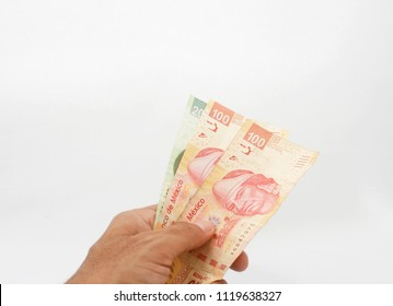 A Hand Giving Mexican pesos bills