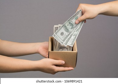 Hand giving money into the box,Donate concept,Payment concept.