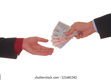 A hand giving money to other hand isolated on white background