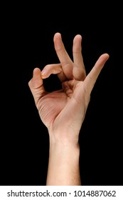Hand giving OK sign. Gesture showing everything is alright. Success and great result.