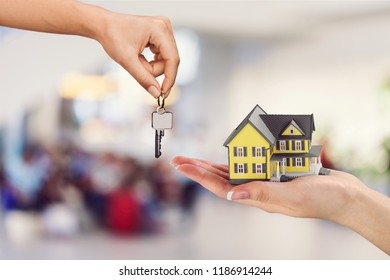 Hand giving set of house keys