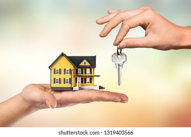 Hand giving set of house keys          - Image