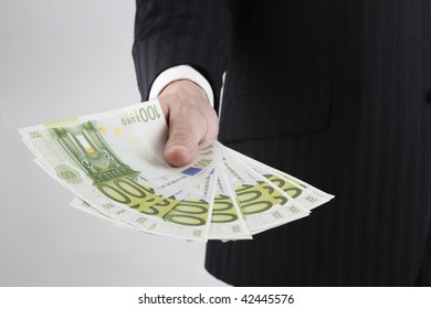 hand giving or showing 100s of euro in his hand