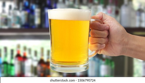 Hand with glass beer isolated on a white background