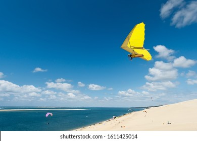 hand glider soaring on the beach with blue sky