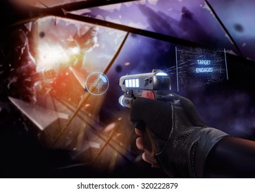 Hand in gloves holding a handgun. First person view hand in black leather gloves holding a futuristic neon fantasy handgun with neon indicators and pointers.