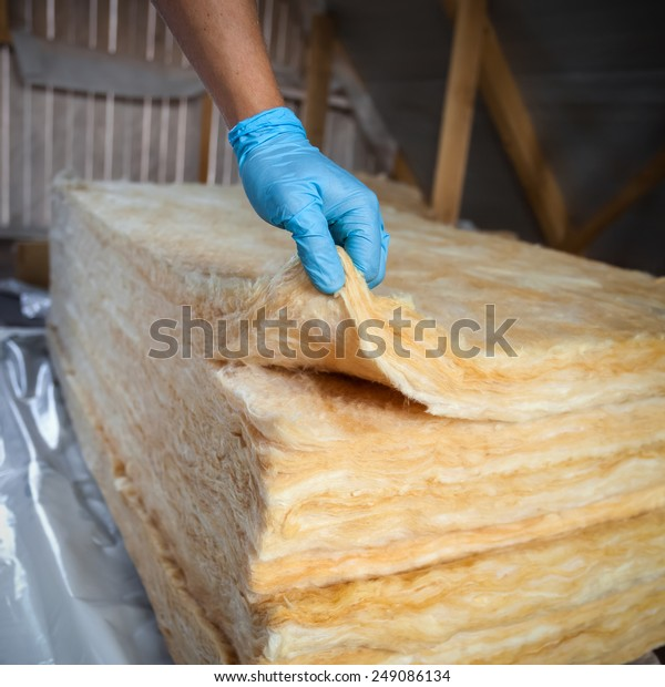 Hand Gloves Holding Mineral Wool Building Stock Photo -6244