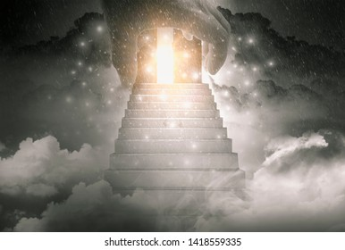 The hand of God and stairway to travel to the gates of heaven and the light of hope, the background is brightness and rainy sky with the concept of pure spirit of mind and spirituality afterlife.