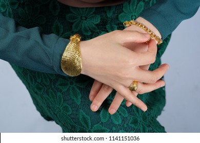 Hand with gold bracelet, ring, jewelry