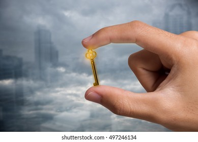 hand with gold key. concept unlock business success.