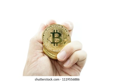 hand with golden bitcoin coin on the white background.