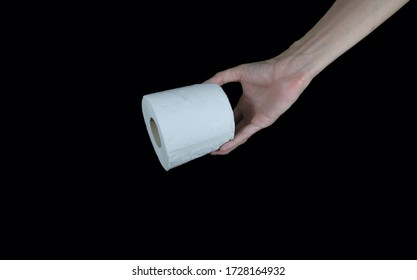 Hand Grabbing toilet paper roll  on black background