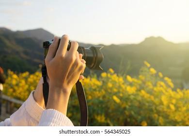 Hand grap camera shooting scenery with sun light.