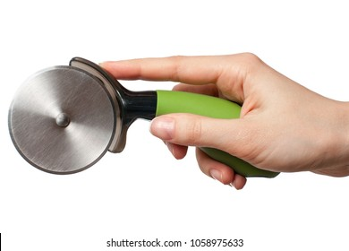 Hand with green pizza cutter isolated on white background.