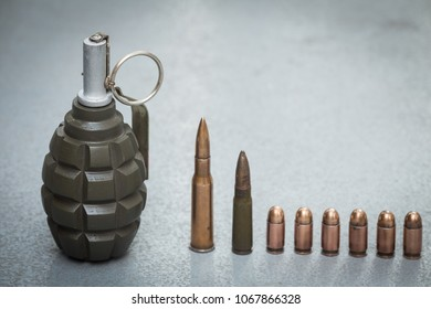 Hand grenade, cartridges and scales from various types of weapons