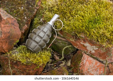 Hand grenade lying on a brick wall