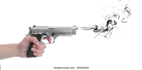 A hand gripping a pistol grip hand gun isolated on white background with black smoke with copyspace with room for your text