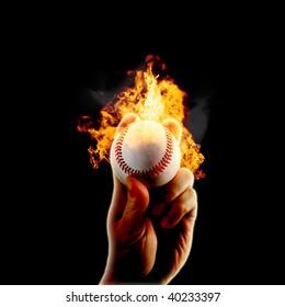 Hand grips baseball on fire
