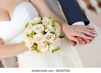 Hand of the groom and the bride at a wedding party