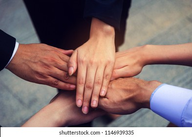 hand of group of business people team joining hands together in the modern city, team leader, successful, support, meeting, partner, teamwork, community, confident and connection concept