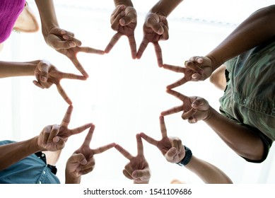 Hand a group of people in the form of stars .Young group are join hands for job success, symbolizing the hands to unity and teamwork ,success ,helps , business concept.