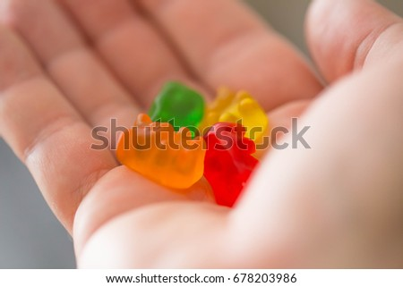 Hand with Gummy Bears Candies