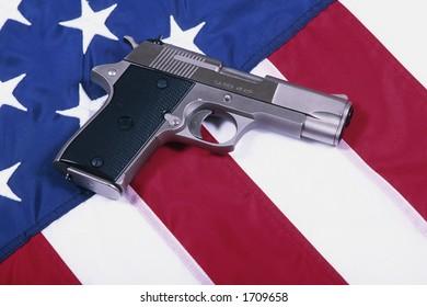 Hand gun and American flrg