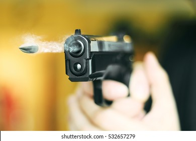 hand gun automatic pistole with flying bullet fire