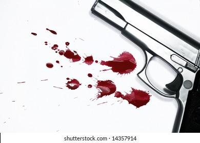 Hand gun and blood splatter. Murder Scene