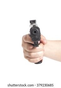 Hand with gun isolated on white
