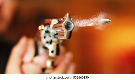 hand gun revolver with flying bullet fire