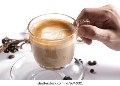 Hand hanging a Cappucino cup