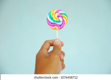 hand held rainbow loly candy