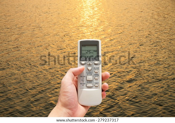 Hand held remote control direct to sunset water surface set temperature at 25 degree , controls imagine the weather