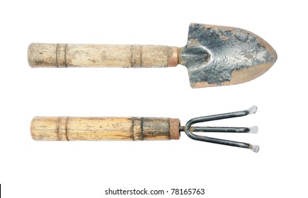Hand held spade and gardening fork. isolated on a white background.
