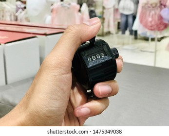 Hand held tally counter in black color.