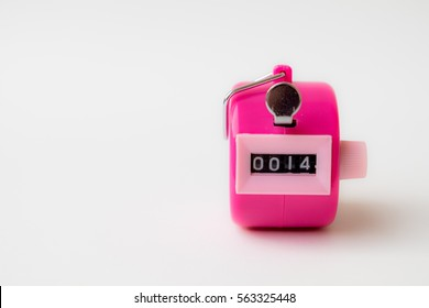 Hand held tally counter in pink color show number with white background, valentine concept.