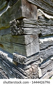 The hand hewn logs of this rustic cabin  home features mortar chinking and a beautiful silver hue to the wood.