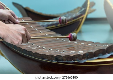 Hand hitting the Thai musical instrument (xylophone),asian instrument, focus on hand