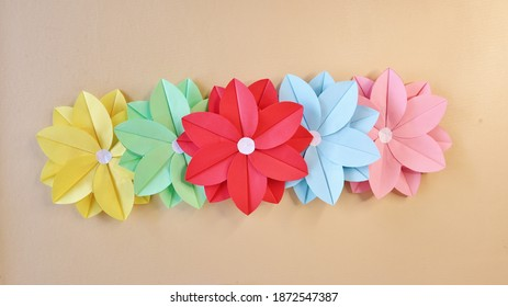 Hand hold Beautiful Flower Origami Paper