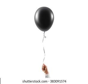 Hand hold blank black balloon mock up isolated. Balloon with black ribbon art design mockup holding in hand. Dark balon presentation. Grey baloon holer hand. Clear gray ballon ready for your logo.