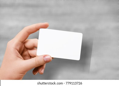 Hand hold blank translucent card mockup with rounded corners. Plain clear call-card mock up template holding arm. Plastic transparent acrylic namecard display front.