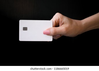 Hand hold blank white card mockup with rounded corners. Plain call-card mock up template holding arm. Business branding on black backgroud