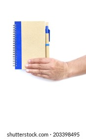 Hand hold brown and notebook with the pen on isolated white