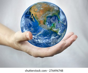 hand hold earth.,   Planet world. Elements of this image furnished by NASA