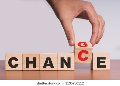 "Hand hold flip wooden cube with word ""change"" to ""chance"""
